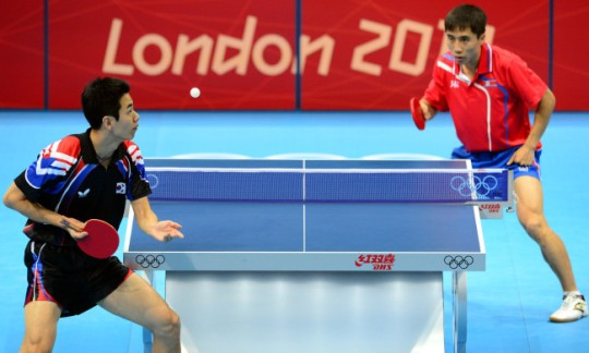 North Korea faces South Korea in ping pong.
