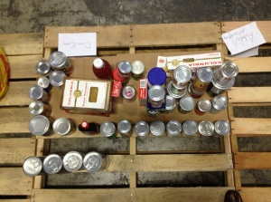 Overhead view of a pallet with cans.